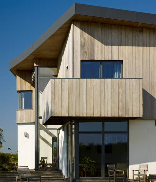 Modern timber cladded house combines the design with composite windows