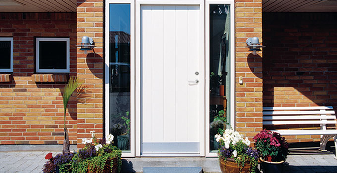 White combined wood and aluminium front door looks great to brick house
