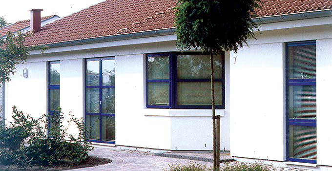 House with blue coloured window frames