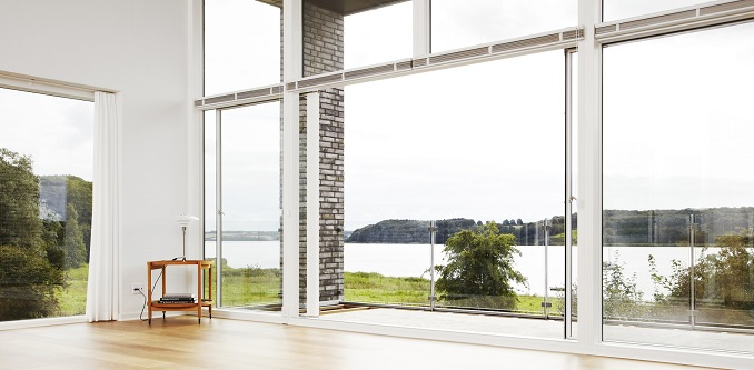 Bi-parting sliding door allows for a big opening in the middle to the balcony