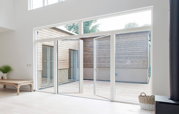 Casement doors in a white aluminium finish brings more light into the home